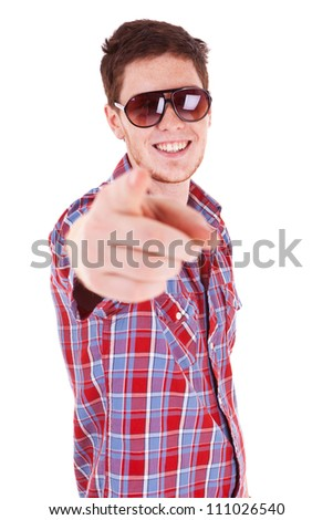 Portrait of a young freckled man wearing shades and pointing at the camera, isolated on white