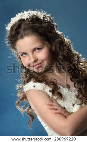portrait of a young girl. emotsiyi.modna beautiful hairstyle. gorgeous, long curly hair - stock photo