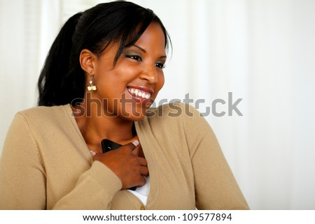 Portrait of a young girl excited about a message from the mobile - stock photo