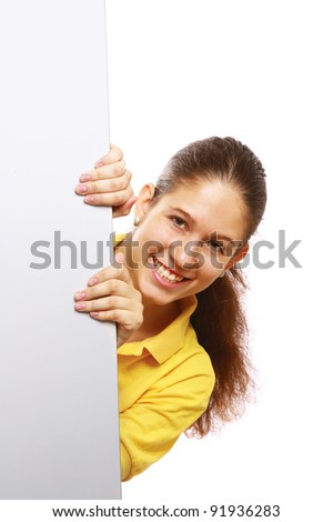 Portrait of a young girl holding a blank card deside her.isolated on white background - stock photo