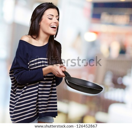 Portrait Of A Young Girl Holding A Frying Pan, Background