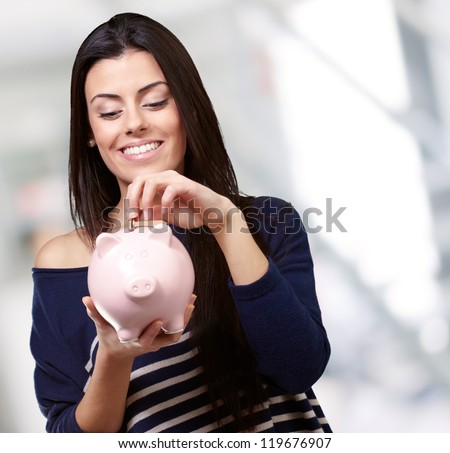 Portrait Of A Young Girl Holding A Piggy Bank, Background