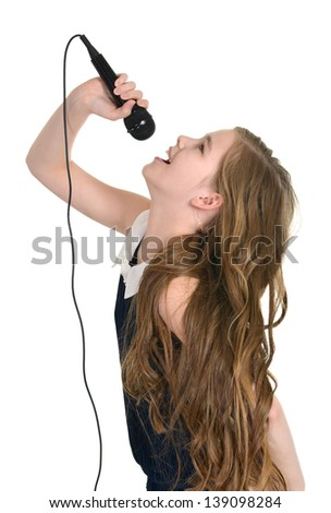Portrait of a young girl in a blue dress singing on a white background - stock photo