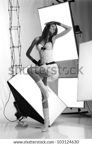 portrait of a young girl in a photo studio - stock photo