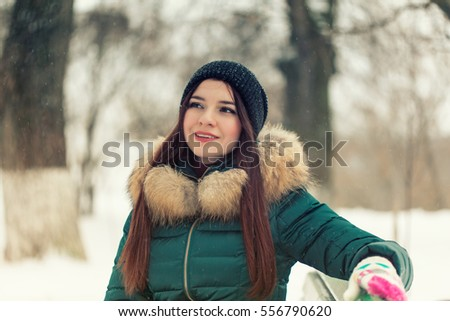Portrait of a young girl in a winter park