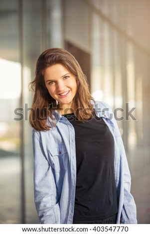 Portrait of a young girl in front of business center - stock photo