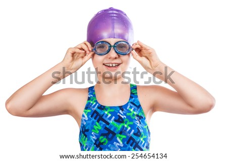 Portrait of a young girl in goggles and swimming cap. happy girl - stock photo