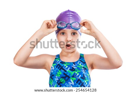 Portrait of a young girl in goggles and swimming cap. surprised girl - stock photo