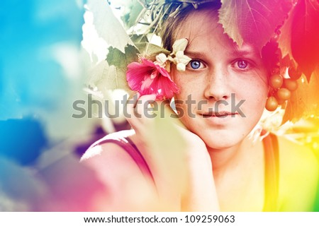 Portrait of a young girl in park.