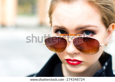 Portrait of a young girl in sunglasses close-up, shallow depth of field - stock photo