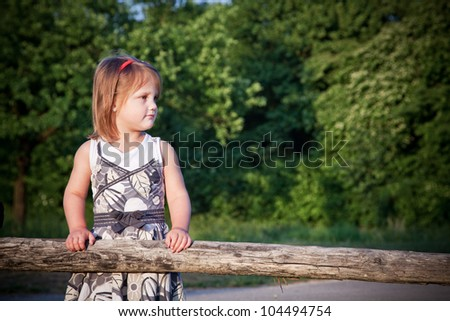 Portrait of a young girl in the park. - stock photo