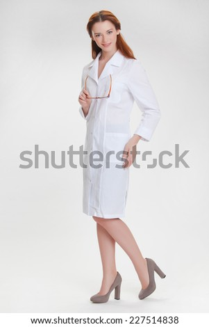 Portrait of a young girl in white  medical lab coat - stock photo