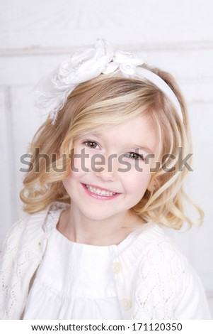 Portrait of a young girl, kindergarten age. - stock photo