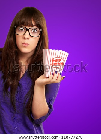 Portrait Of A Young Girl Making Face On Purple Background - stock photo