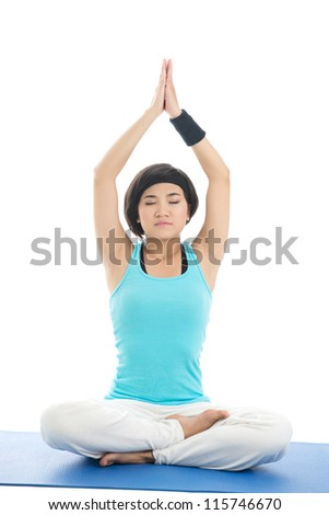 Portrait of a young girl meditating isolated on white - stock photo