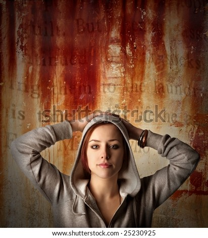 portrait of a young girl on a crack rust background - stock photo