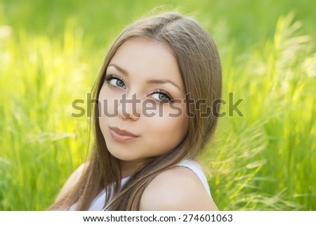 Portrait of a young girl on the nature