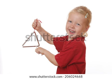Portrait of a young girl playing a triangle on white background - stock photo