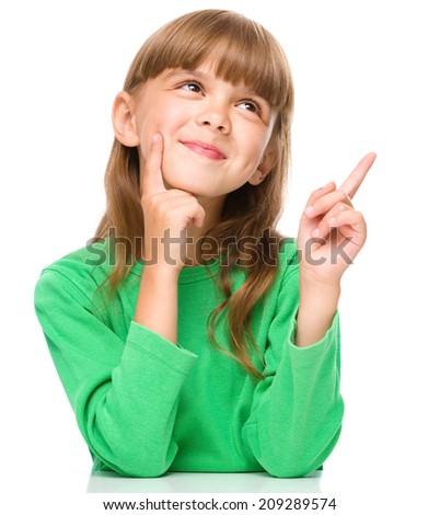 Portrait of a young girl pointing up using index finger, isolated over white - stock photo