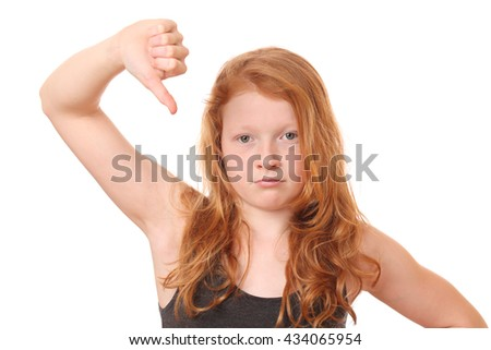Portrait of a young girl showing thumbs down on white background - stock photo