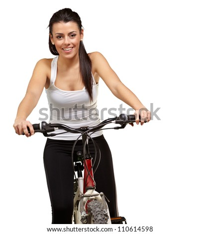 Portrait of a young girl sitting in bicycle isolated on white background - stock photo
