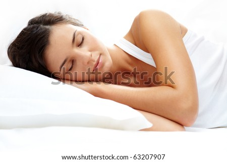 Portrait of a young girl sleeping on a pillow - stock photo