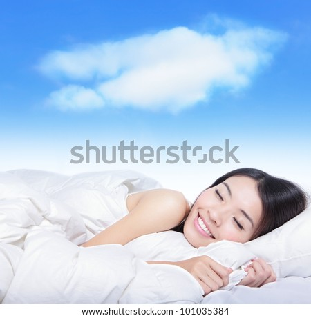 Portrait of a young girl sleeping on a pillow with white cloud over her , model is a asian beauty - stock photo