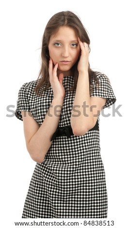 Portrait of a young girl touching her face with hands against white background - stock photo