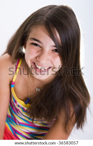 Portrait of a young girl with a big smile on her face