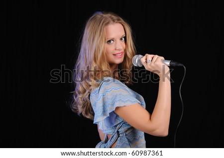 portrait of a young girl with a microphone - stock photo