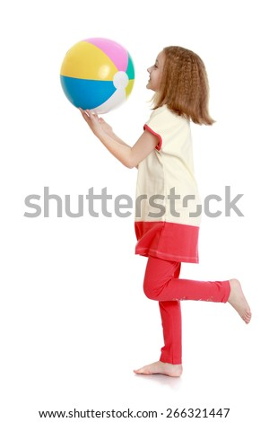 portrait of a young girl with ball in hand- isolated on white background