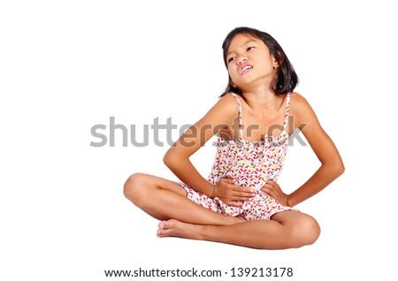 Portrait of a young girl with stomach pain. - stock photo