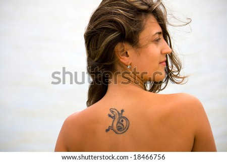 portrait of a young girl with tattoos on her back