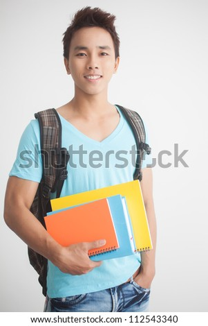 Portrait of a young guy with books - stock photo