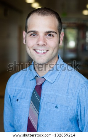 portrait of a young handsome businessman at office