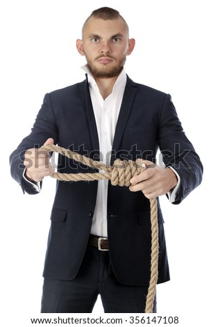 Portrait of a young handsome businessman with a rope around his neck on a white background studio - stock photo