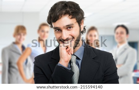 Portrait of a young handsome leader - stock photo