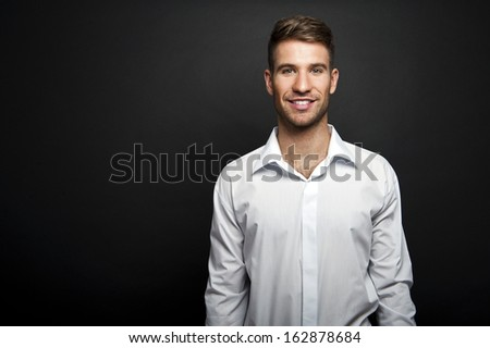 Portrait of a young handsome man a white shirt - stock photo