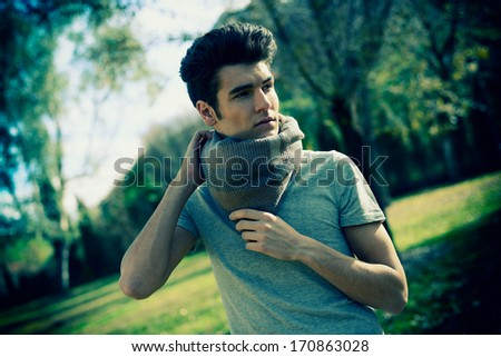 Portrait of a young handsome man in the park - stock photo
