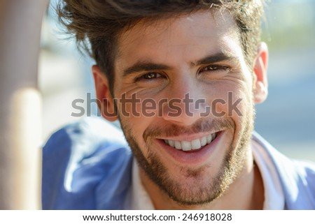 Portrait of a young handsome man smiling - stock photo