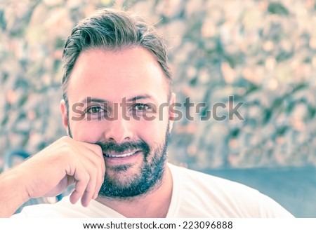 Portrait of a young handsome man with a candid natural smile - Concept of sincerity and reliability - Modern vintage filtered look - stock photo