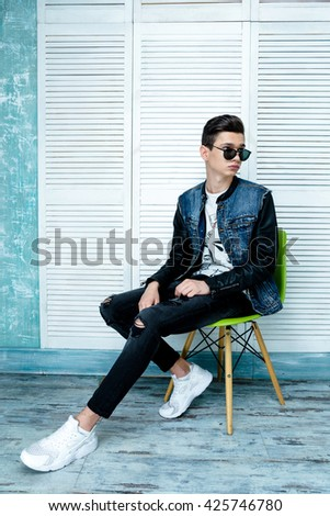 Portrait of a young handsome teenager boy. Model wearing stylish casual clothes. City lifestyle. Male fashion, street style concept. - stock photo