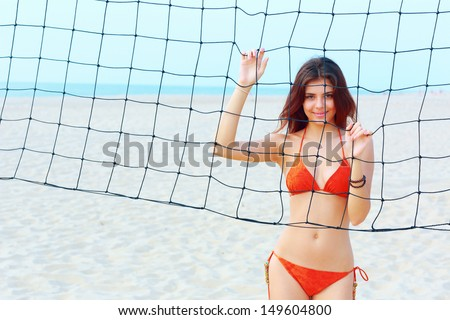 Portrait of a young happy beautiful woman on the beach - stock photo
