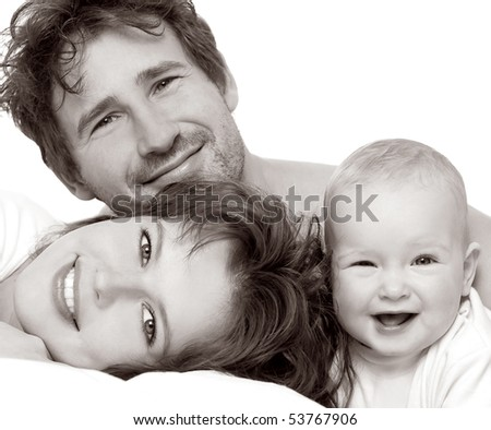 Portrait of a young happy family with the kid on a white background - stock photo