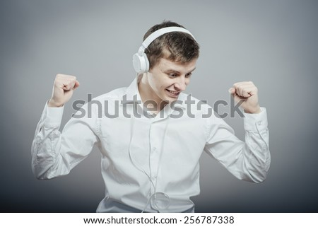 portrait of a young happy man listening to music