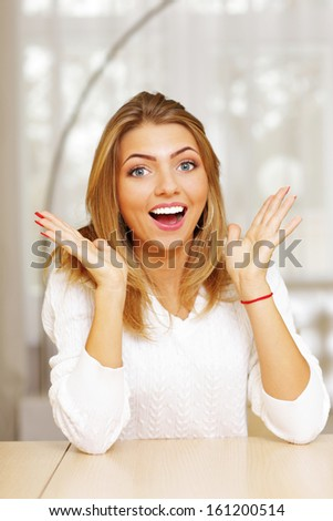 Portrait of a young happy surprised woman - stock photo