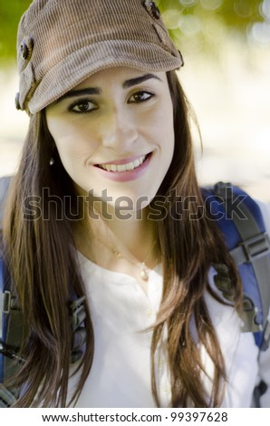 Portrait of a young happy woman smiling on a hiking trip
