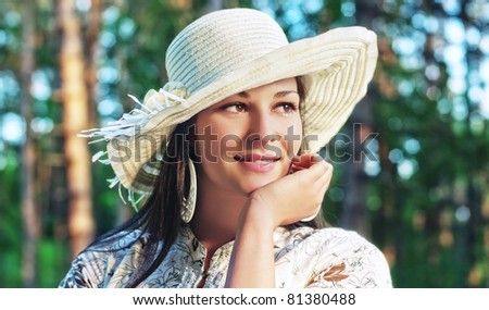 Portrait of a young happy women in park