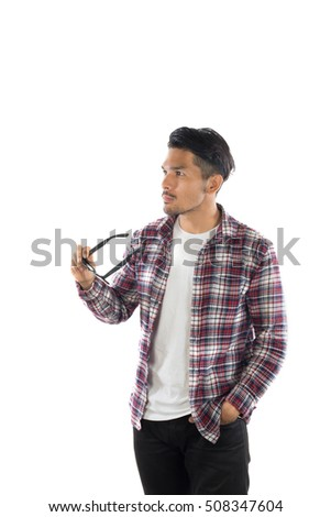 Portrait of a young hipster man standing isolated on a white background