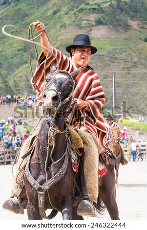 Portrait Of A Young Hispanic Cowboy Throwing A Lasso, South America Competition  - stock photo